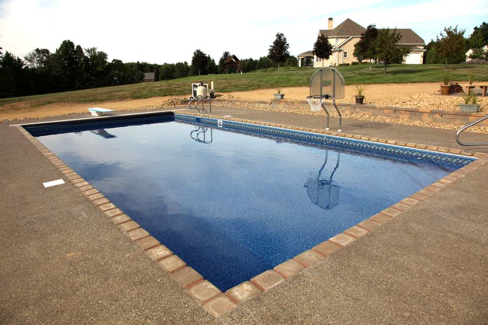 pavers around pool rectangle inground pool blue pool water